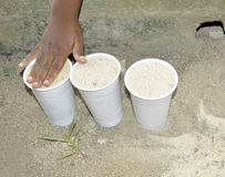 AFRICAN CHILD'S PLAY. African children hand Image innocently playing in the sand all happy without worrying about germs. How beautiful child Royalty Free Stock Photo