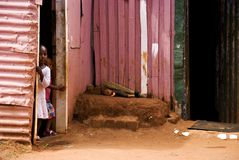 African children. Two african children standing at the door of their township shack. Poverty is very common in South African townships and all over Africa royalty free stock image