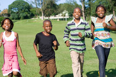 African children. Running in the park towards camera Royalty Free Stock Image