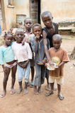African children. Anekro, Ivory Coast - August 20, 2015: African children gathered in front of their house, are happy to take a picture together Stock Images