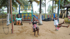 AFRICAN CHILDREN GAMES. It's wonderful to see African children very happy to have fun together on the swings at the beach Royalty Free Stock Photography
