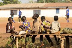 African children in ghana. Accra, Ghana - January 01, 2017: Happy african children play cards in Accra, Ghana Royalty Free Stock Images