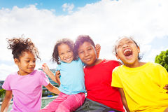 African children having fun outdoors in summertime. Close-up portrait of four age-diverse African children having fun outdoors in summertime royalty free stock image
