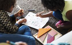 African children having a good time drawing Stock Photography