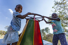 African children on merry-go-round Stock Photo