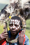 African children with ostrich feather headdress  and painted markings of face Stock Image