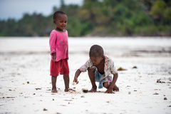 African children playing. Even facing poor life conditions, children in rural Africa are joyful, optimistic and eager to have fun. Image taken on the beach of Stock Photo