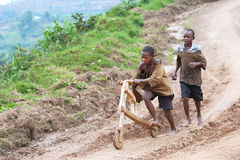 African children playing with wooden scooter, Ugan Stock Images