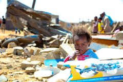 African Children in a Tornado damaged Township royalty free stock image