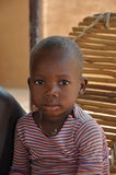African children in a village. An African children with a sad look Stock Photos