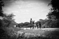 African children walking home with football Royalty Free Stock Photos