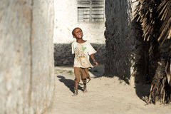 African children in Zanzibar Island. Even facing poor life conditions, children in rural Africa are joyful and playful Royalty Free Stock Photo