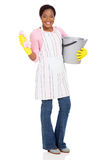 African cleaner bucket. Beautiful african cleaner holding a bucket and a cloth on white background Stock Photo