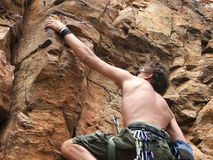 African Climber. A man mountian climbing is South Africa in the summer royalty free stock image