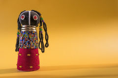 Free African Cloth Doll On Yellow Background Royalty Free Stock Photography - 93870067
