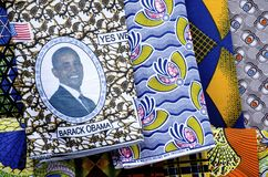 African Cloth Patterns. Brightly colored cloth with African patterns including one with the American flag and a portrait of President Obama stock images