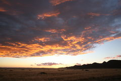 African clouds. Sunset with dramatic sky in Namibia Royalty Free Stock Photography