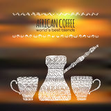 African coffee design with pot and cups on blurred. Original African coffee design with coffee pot and cups decorated with hand drawn ethnic pattern paced on Stock Photo
