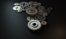 African Cogwheel Machine. A concept showing an array of metal and steel cogwheels assemed into the shape of the african continent on a dark surface background Stock Image