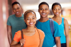 African college friends. Beautiful african college girl with friends on campus Royalty Free Stock Photo