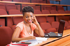 African college student. Beautiful female african college student in lecture room Royalty Free Stock Image