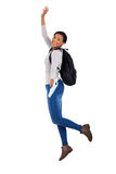 African college student jumping. Cheerful young female african college student jumping on white background Royalty Free Stock Images