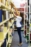 African college student reaching book Stock Photo