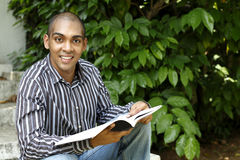African college student smiling. Smart looking, handsome colleague student of African, Mauritian heritage Stock Photo