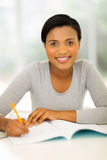 African college student studying. Portrait of african college student studying at home Royalty Free Stock Photos