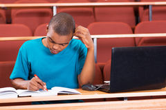 African college student. Young african american college student studying in lecture hall Stock Image