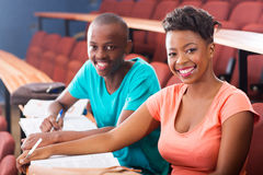 African college students. Portrait of two african college students sitting in classroom Stock Photography