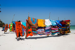 African colors fabric on beach Royalty Free Stock Images