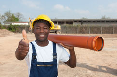 African construction worker with pipe showing thumb Stock Image