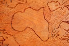 African continent in wood. Shape of the African continent and African animals carved in wood Stock Image