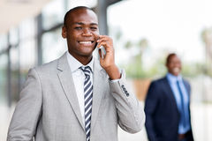 African corporate worker talking. Handsome african corporate worker talking on mobile phone stock photos