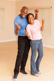 African couple celebrating Royalty Free Stock Photography