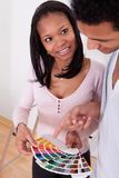 African couple choosing color for new home Stock Image