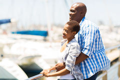 African couple daydreaming royalty free stock photography