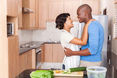 African couple embracing kitchen Royalty Free Stock Photo