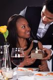 African couple with a gift in hands Stock Image