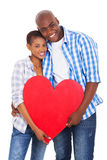 African couple holding heart Royalty Free Stock Images