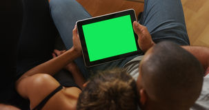 African couple holding tablet with greenscreen Stock Photo