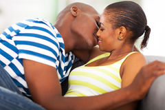 African couple kissing stock photos
