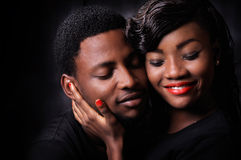 African couple love. African American couple love against black background