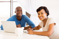 african couple paying bills Royalty Free Stock Photo