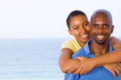 African couple piggyback Royalty Free Stock Image