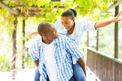 African couple piggyback Stock Image