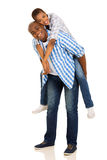 African couple piggyback Stock Photos