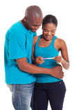 African couple pregnancy test Stock Images