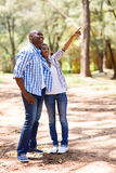 African couple relaxing outdoors Stock Images